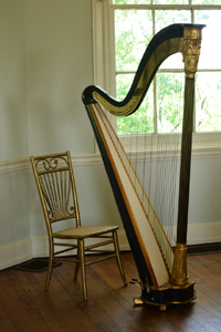 In the famous octagon room of Laurel Hill Mansion the site of the summer music series Concerts by Candlelight sits a beautiful harp.