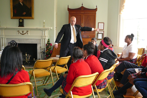 During the 2014 Constitution program at Laurel Mansion lawyer describes a case to the students of HCS.