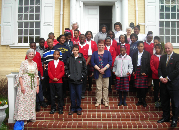 Student participants from HCS, their social studies teacher, Scott Griffiths from Rawle and Henderson Law Firm and volunteers from Woman For Greater Philadelphia pose on the front steps of Laurel Hill Mansion just prior to the 2014 Constitution symposium.
