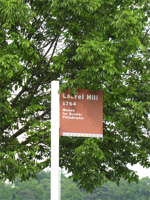 Wooden Park sign pointing the way to Laurel Hill Mansion in Philadelphia PA