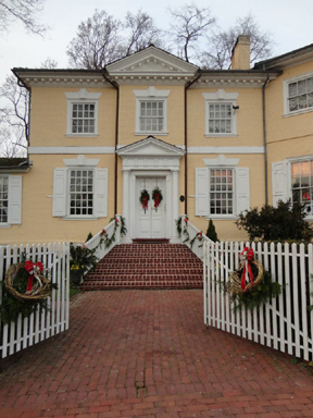 Image of the facade of Laurel Hill Mansion with winter holiday decorations