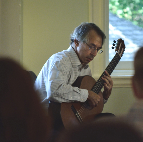 Renown classical guitarist Allen Krantz performing in the octagonal room at historic Laurel Hill Mansion in Philadelphia PA as part of the 2014 Summer concert series held there.