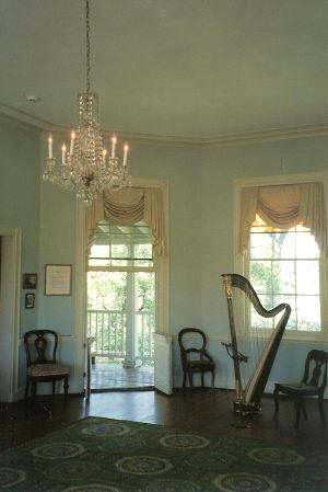 A harp stands in the beautiful Octagon Room of Laurel Hill Mansion wjhere the music series Concert by Candlelight is hosted.